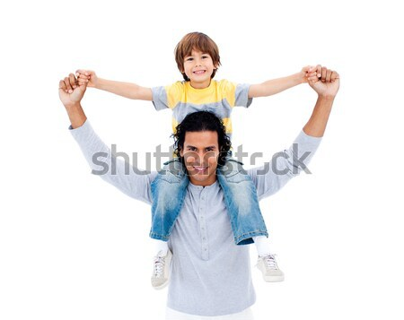 Attentive father playing with his son against a white background Stock photo © wavebreak_media