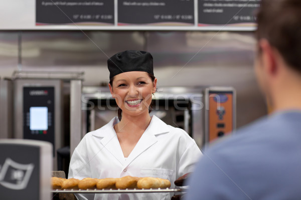 Vidám fiatal pék bagettek konyha étel Stock fotó © wavebreak_media