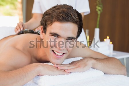 Passionate woman doing a massage to her boyfriend lying on their bed at home Stock photo © wavebreak_media