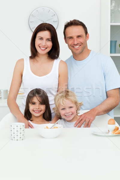 Happy parents posing with their children in the kitchen during breakfast Stock photo © wavebreak_media