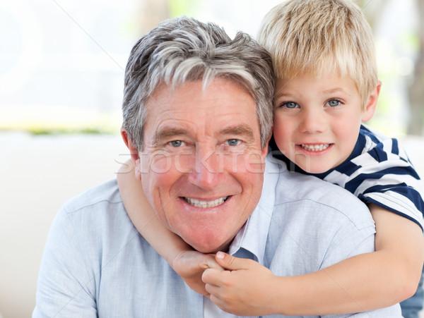 Kicsi fiú nagyapa néz kamera jókedv Stock fotó © wavebreak_media