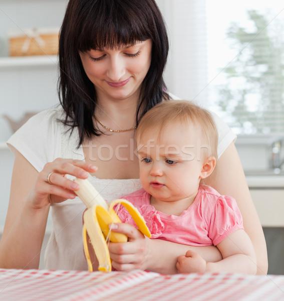 очаровательный брюнетка женщину банан ребенка Сток-фото © wavebreak_media