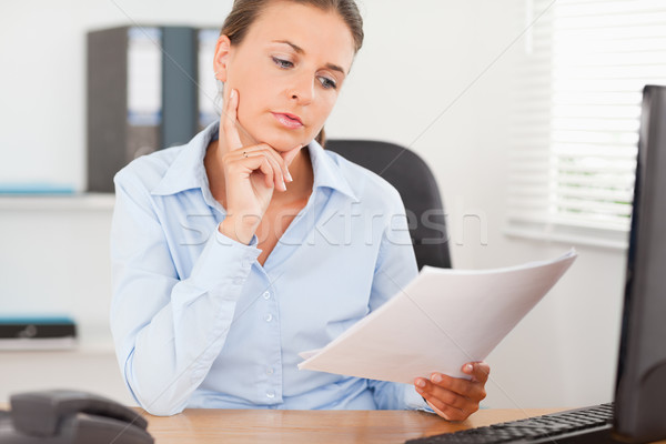 Portrait of a businesswoman concentrating on a paper in the office Stock photo © wavebreak_media
