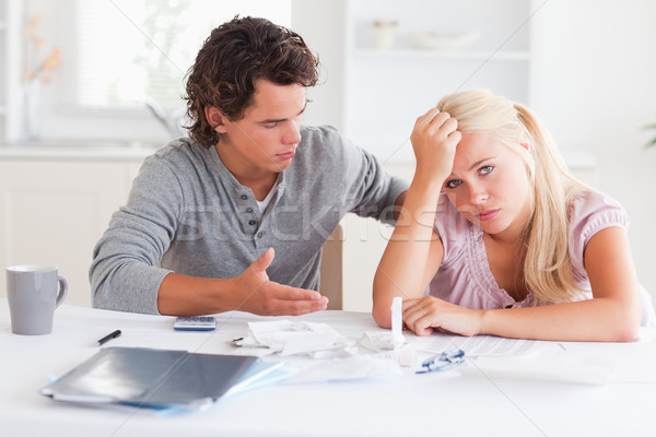 Despaired couple doing their accounts in the living room Stock photo © wavebreak_media