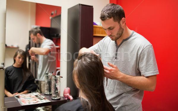 Male hairdresser cutting hair with scissors Stock photo © wavebreak_media