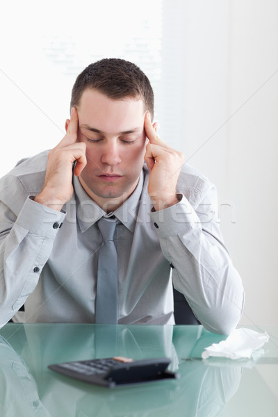 Young businessman not happy with his calculations Stock photo © wavebreak_media