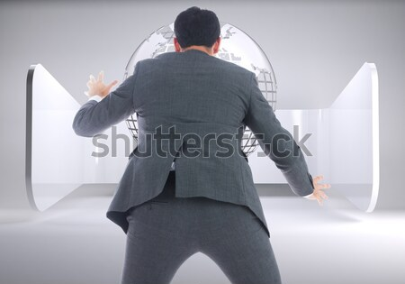 Portrait of a businessman hiding his face behind a blank panel against a white background Stock photo © wavebreak_media