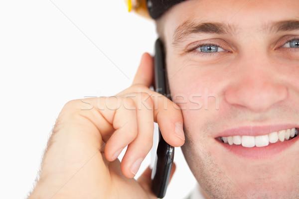 Közelkép jóképű építész készít telefonbeszélgetés fehér Stock fotó © wavebreak_media