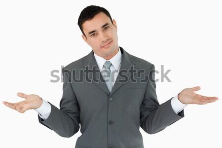 Businessman clueless against a white background Stock photo © wavebreak_media