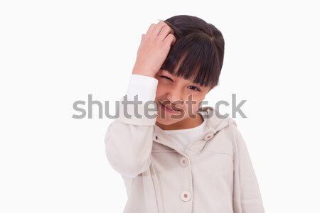 Cute girl thinking against a white background Stock photo © wavebreak_media