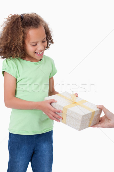 Portrait of a young girl receiving a present against a white background Stock photo © wavebreak_media