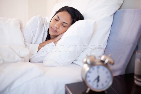 Oldalnézet fiatal nő alszik óra ágy belső Stock fotó © wavebreak_media