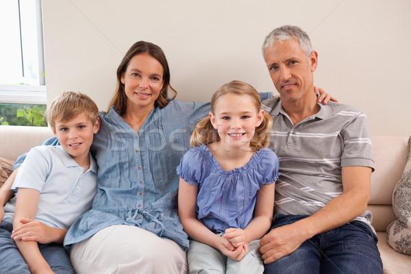 счастливая семья сидят диван глядя камеры семьи Сток-фото © wavebreak_media