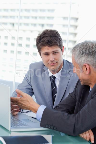 Senior businessman with megaphone yelling at his employees Stock photo © wavebreak_media