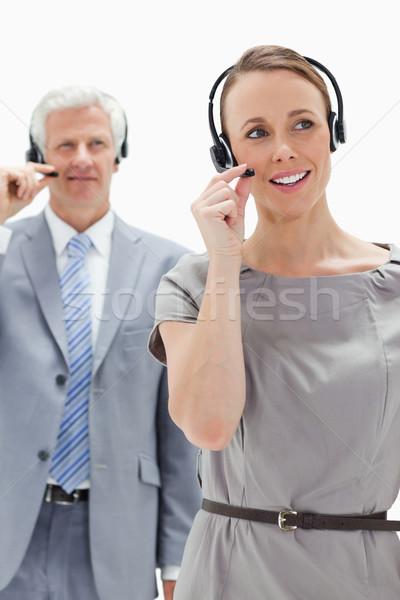 Kadın kulaklık beyaz saçlı işadamı Stok fotoğraf © wavebreak_media