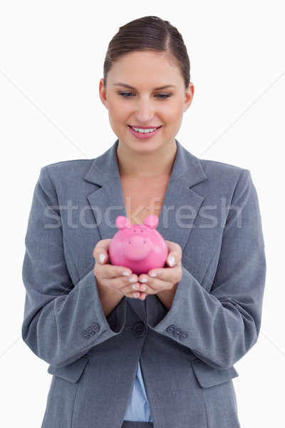 Smiling bank clerk with piggy bank against a white background Stock photo © wavebreak_media