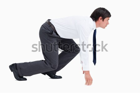 Side view of young tradesman in sprinting position against a white background Stock photo © wavebreak_media