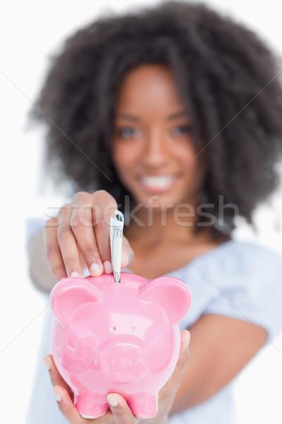 Stok fotoğraf: Genç · kadın · notlar · kumbara · beyaz · eller · gülümseme