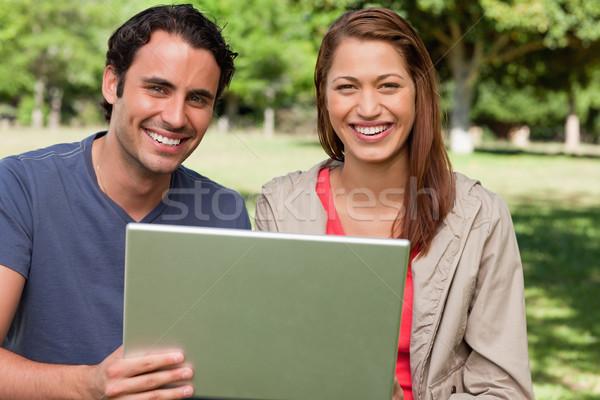 Dois amigos alegremente olhando à frente manter Foto stock © wavebreak_media