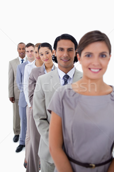 Close-up of co-workers in a single line looking straight with focus on the second woman against whit Stock photo © wavebreak_media