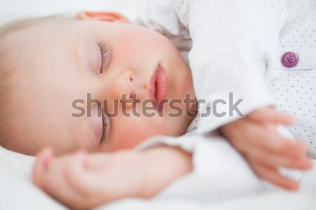 Peaceful baby lying while falling asleep in a bedroom Stock photo © wavebreak_media