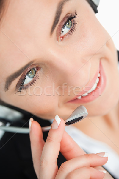 Green eyed woman with headset looking away in close-up Stock photo © wavebreak_media