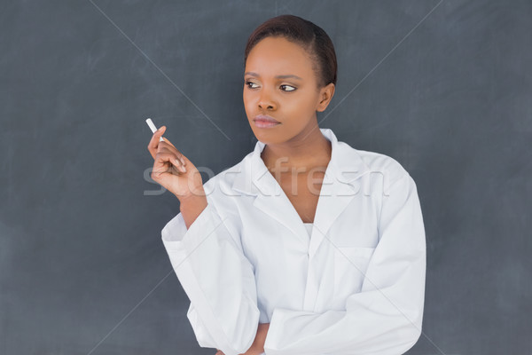 Front view of a teacher holding a chalk in a classroom Stock photo © wavebreak_media
