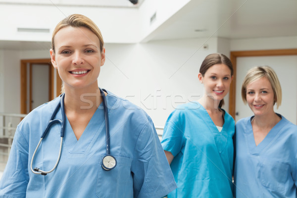 Two nurses in the background and one in the foreground in hospital corridor Stock photo © wavebreak_media