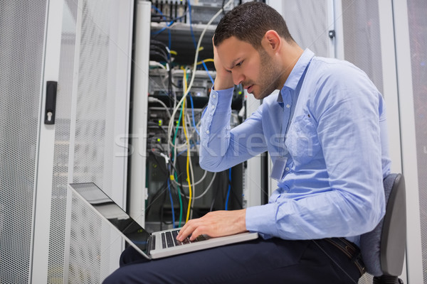 Technician becoming stressed over servers in data center Stock photo © wavebreak_media