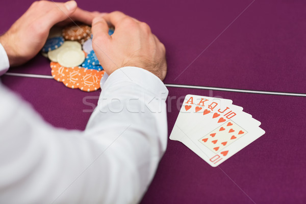 Man winning at poker with royal flush in casino Stock photo © wavebreak_media