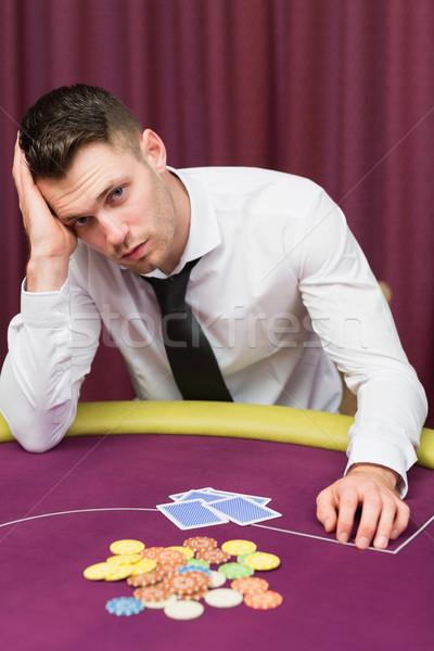 Man looking unhappy at poker table in casino Stock photo © wavebreak_media
