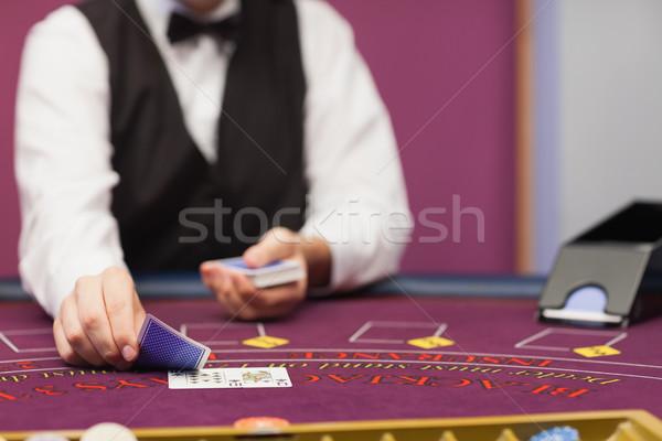 Revendeur séance casino table cartes Photo stock © wavebreak_media