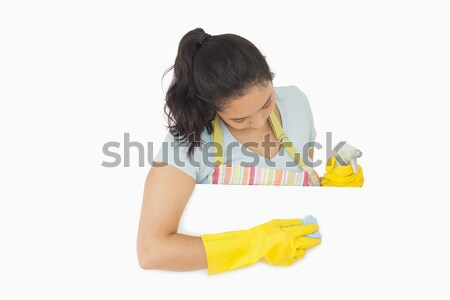 Happy woman with blue rag leaning on white surface wearing rubber gloves and apron Stock photo © wavebreak_media