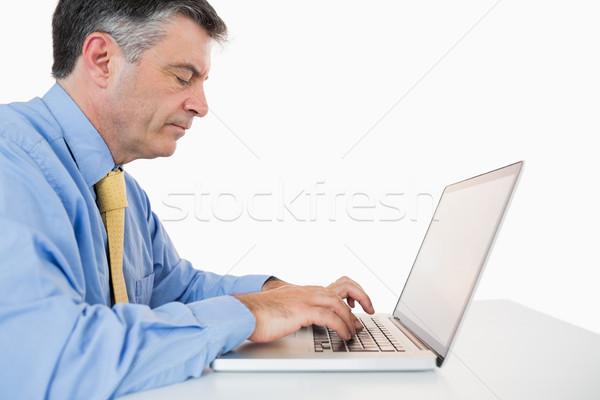 Koncentrált férfi ír laptop asztal fehér Stock fotó © wavebreak_media