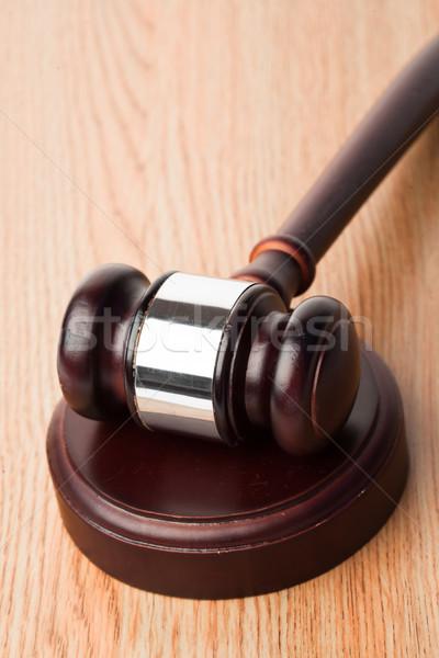 Gavel and a wood sound block on desk  Stock photo © wavebreak_media