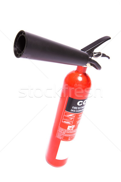 Red fire extinguisher on a tilt Stock photo © wavebreak_media