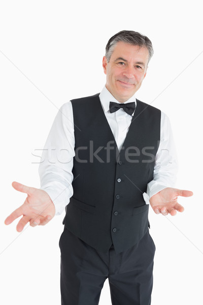 Man in waistcoat with arms out Stock photo © wavebreak_media