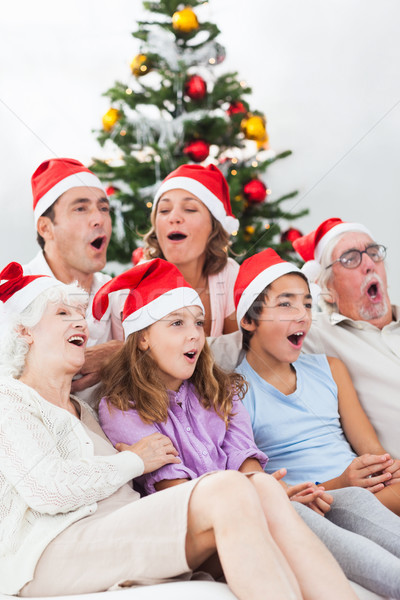 Extended family singing carols Stock photo © wavebreak_media