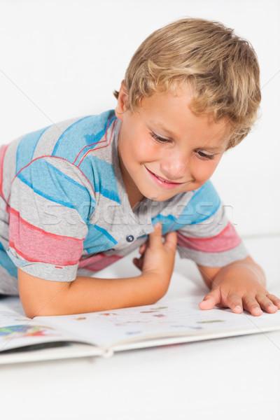 Happy boy reading a storybook Stock photo © wavebreak_media