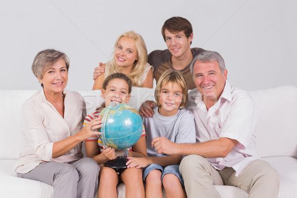 Família retrato olhando câmera globo sessão Foto stock © wavebreak_media