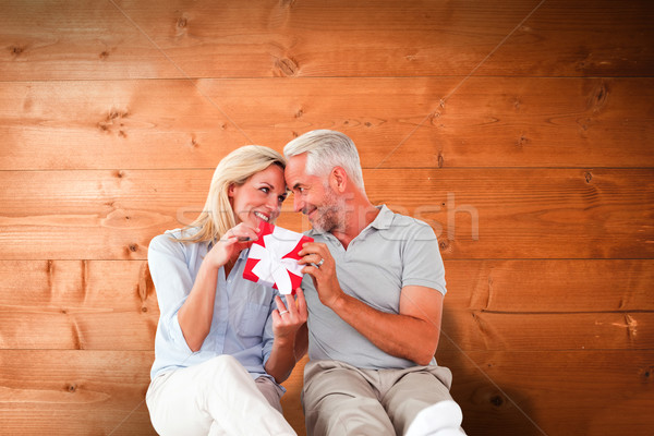 összetett kép boldog pár ül tart Stock fotó © wavebreak_media