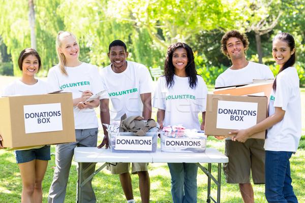 önkéntesek adomány dobozok portré fiatal park Stock fotó © wavebreak_media