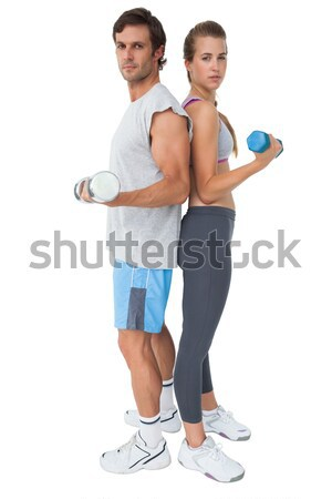 Portrait of a fit young couple exercising with dumbbell Stock photo © wavebreak_media