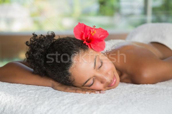 Gorgeous woman lying on massage table with salt treatment on bac Stock photo © wavebreak_media