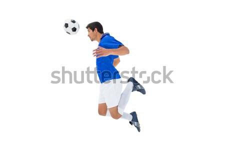 Futballista kék ugrik labda fehér sport Stock fotó © wavebreak_media