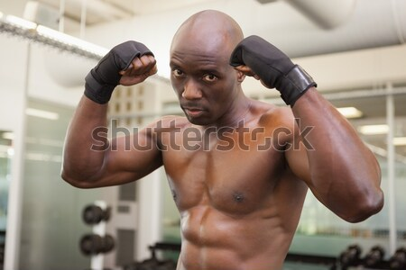 Shirtless muscular man holding frying pan in gym Stock photo © wavebreak_media