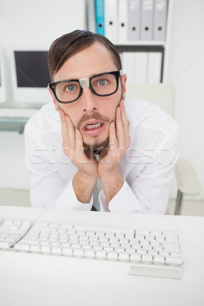 Nerdy nervous businessman working on computer  Stock photo © wavebreak_media