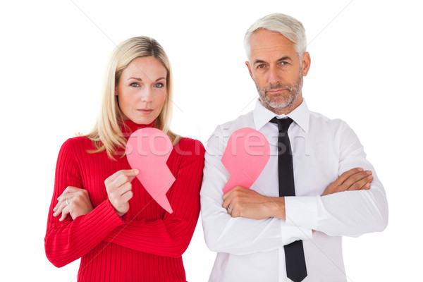 Couple not talking holding two halves of broken heart Stock photo © wavebreak_media