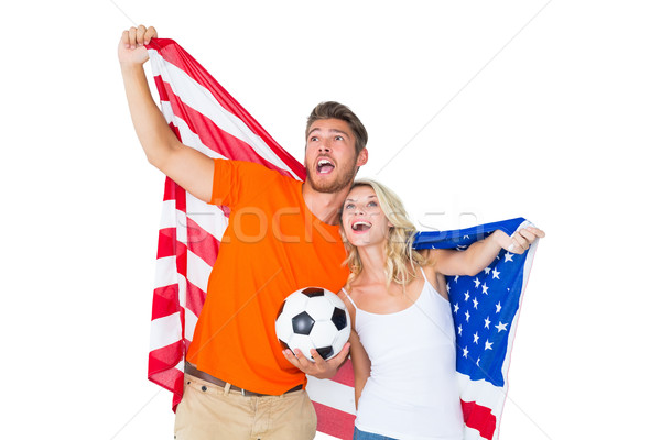 Excited football fan couple holding usa flag Stock photo © wavebreak_media