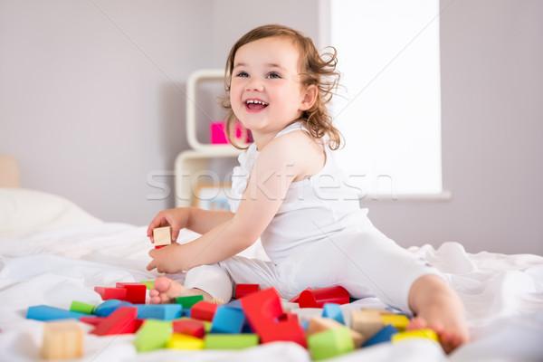 Cute девушки играет блоки кровать девочку Сток-фото © wavebreak_media